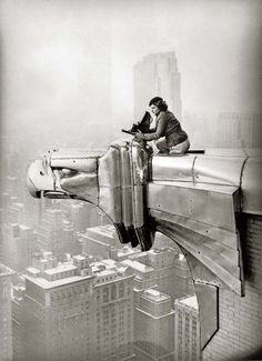 Photographer Margaret Bourke-White on a gargoyle at the top of the Chrysler Building, New York, 1935, photo by Oscar Graubner.