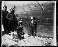 90.13.1.182 Jacob A. (Jacob August) Riis (1849-1914) Two Greek children in Gotham Court debating if Santa Claus will get to their alley or not. He did. DATE:ca. 1890 Museum of the City of New York