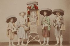 Pilgrim priests with portable shrine. Hand colored photographs capture Japanese life during the Meiji Period, 1890, taken by Japanese photographer, Kusakabe Kimbei.