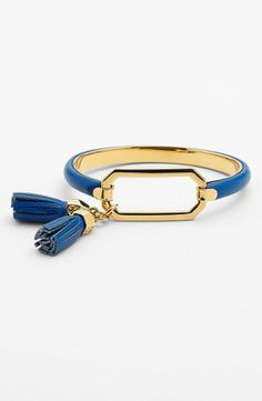 Getting nautical vibes from this blue Tory Burch tassel bangle.