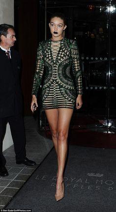 Gigi Hadid flaunts her extraordinary legs in skin-tight mini in Paris #dailymail