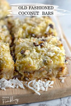 These gooey coconut bars with chocolate chips are an easy dessert filled with lots of coconut and a little bit of chocolate. A soft shortbread crust is topped off with a rich coconut and chocolate layer! This is a great recipe to share with friends and family. Easy dessert to bring to a cookout or pot luck dinner. Unique Desserts, Easy Desserts, Delicious Desserts, Dessert Recipes, Yummy Food, Scone Recipes, Dinner Recipes, Coconut Bars, Coconut Recipes