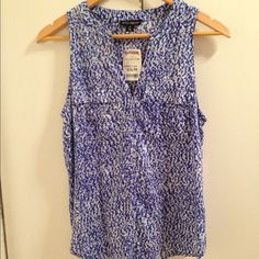 Baby Blue Beautiful sleeveless blue blouse! Two little front pockets. Brand new with tag. Never worn. 100% Rayon. Size small. 20% off two items or more. trades  PP. Reasonable offers always welcome  Willi Smith Tops Blouses