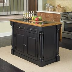 The monarch kitchen island blends upscale design with state of the art functionality. Stylish design features include a solid hardwood distressed oak finished top with profiled edges and a black gran...