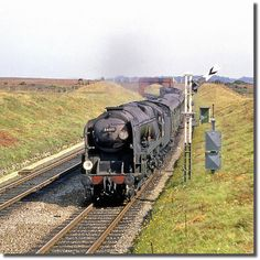 1964: 34001 'Exeter'    A down semi-fast climbs between Lymington Junction and Sway. Hampshire, England. Transparency scan.