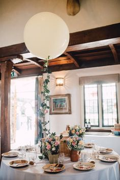 Picnic basket wedding breakfast with Jugs of flowers & Giant balloons -   Image by Kerry Diamond Photography - Bride wears Bespoke Gown & Veil by Dana Bolton. Outdoor Ceremony at Voewood House in Norfolk with Picnic Wedding Breakfast & Lawn Games.