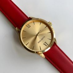 Sustainable and ethically made round watch features a mirrored gold stainless steel case, gold markers and a sustainable red leather band meticulously crafted from surplus leather that would have otherwise gone to waste. Leather Scraps, Red Leather, Watch Faces, Timeless Classic, Stainless Steel Case, Quartz, Mindfulness, Band, Accessories