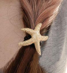 T12 bijoux européens et américains mode de la rue tournage métallique étoiles de mer d'or corde de cheveux de cheveux anneau corde