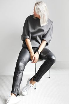 almost-white blonde, slouchy grey top, leather pants & sneakers #style #fashion