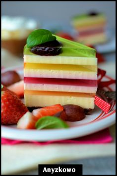 Cake in rainbow colors... (Note: will need to translate page) looks like jelly/cheesecake layers. Fab idea!