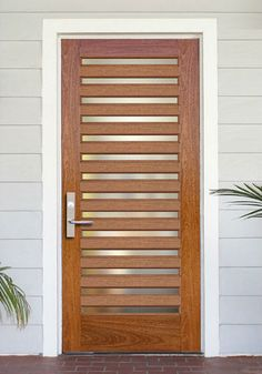 """DbyD-5017.  This Custom Contemporary Front Entry Door was designed and built by Doors By Decora using FSC Certified Wood.  These 36"""" X 80"""" 14 Lite Contemporary Doors was built for a home in Santa Claira, California.  The Glass is Clear Tempered Insulated Glass.  The Hardware is FSB 1176 Lever on 1410 Back Plate 32D."""