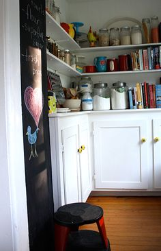 """Sneak Peek: A Massachusetts Farmhouse Where Color and Pattern Meet. """"I once trained in Paris as a pastry chef.  Our kitchen pantry is where I keep a lot of my baking ingredients, tools and cookbooks.  We painted a thin bump-out wall with chalkboard paint to keep a handy grocery list.  This very practical Kik-Step stool by Cramer goes with our cherry red light fixture."""" #sneakpeek"""
