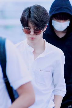 Jimin and jungkook in the back looking like an angel