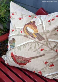 Embroidered bird pillow on red bench | homeiswheretheboatis.net #PottingShed #Christmas #garden