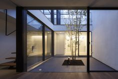 Patio is a minimalist house designed by APOLLO Architects & Associates