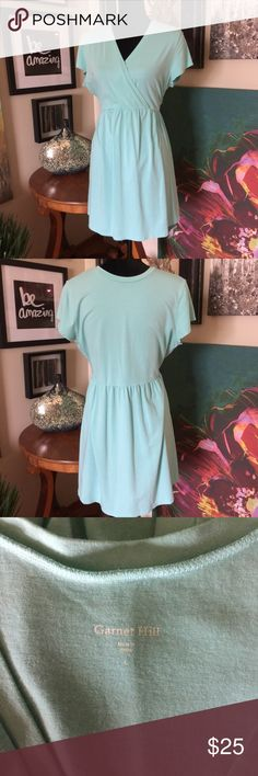 """Garnet Hill V-neck Tunic Another great top from Garnet Hill. Cross over bodice, empire waist with short sleeves. Light and stretchy top/dress. Pit to pit measures 20"""". Shoulder to hem is 33"""". Excellent used condition. Color is Aqua. Size is Large. Garnet Hill Tops Tunics"""
