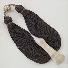 Lei Niho Palaoa  Date: mid-19th century Culture: Hawaiian Medium: hair, ivory, gold, fiber Dimensions: Length: 10 3/8 x 5 3/4 x 2 in. (26.4 x 14.6 x 5.1 cm) Credit Line: Gift of Muriel Kallis Newman, 2008 Accession Number: 2008.190.292