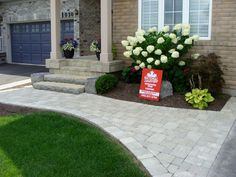 National Landscape, interlocking stone, flagstone, wood structures, and landscaping. Georgetown Ontario Canada