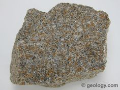 Sandstone is a clastic sedimentary rock made up mainly of sand-size (1/16 to 2 millimeter diameter) weathering debris. Environments where large amounts of sand can accumulate include beaches, deserts, flood plains and deltas. The specimen shown above is about two inches (five centimeters) across.
