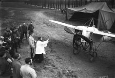 French soldiers gather around a priest as he blesses an aircraft on the Western Front, 1915,  via reddit