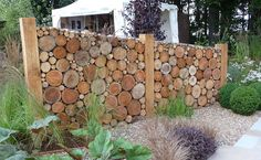 "Log privacy screen. CAUTION: this was a temporary garden show wall. In a windy area, use 12-18"" logs, or figure out how to connect them to each other or a backing for stability."