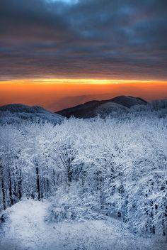Sunset over snowy fields