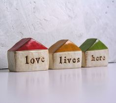 love lives here... Three handmade polymer clay houses ... Word Houses ... instant little neighborhood. $42.00, via Etsy.