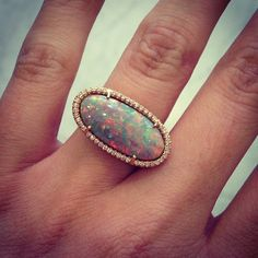 Le sigh...Irene never disappoints. This one of a kind Lightning Ridge opal is surrounded by diamonds and set in 18k rose gold. #ireneneuwirth #lightningridge #opal #oneofakind #diamonds #rosegold #bling #want #new #drool #instagems #instajewels #canihavethat #love #singlestonemissionstreet