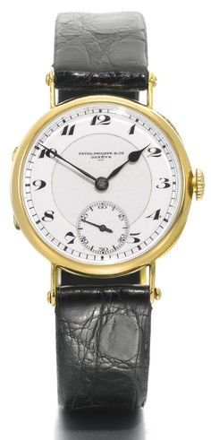 Patek Philippe & Cie RETAILED BY HOMBERGEN ANVERS: A FINE YELLOW GOLD OFFICER WRISTWATCH MVT 184275 CASE 287218 MADE IN 1920  diameter 31 mm
