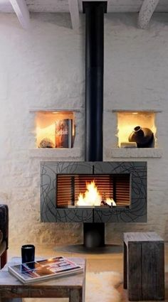 Buy Invicta Symphonia 12 kW Wood Burning Stove from Fast UK Delivery and lowest prices guaranteed. Outdoor Wood Fireplace, Hot Tub Patio, Wood Furnace, Stove Parts, Cast Iron Stove, Stove Fireplace, Wood Burner, Home Appliances, Fireplaces