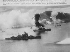 Photo taken during a raid on Rabaul harbor. A Japanese Nachi class cruiser is in the foreground.