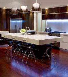 Light And Dark Modern Kitchen!! Love this design and the illumination