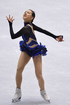 TOKYO, JAPAN - NOVEMBER 09: Mao Asada of Japan competes in the women's free program during day two of ISU Grand Prix of Figure Skating 2013/...