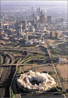 An aerial view of the implosion of Atlanta-Fulton County Stadium on Aug. 2, 1997. The city skyline is in the background. JEAN SHIFRIN / AJC FILE
