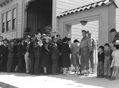 Japanese-Americans outside a Civil Control Station at the Japanese American Citizens League Auditorium, San Francisco, California, United States, 25 Apr 1942