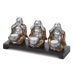 Home Locomotion No Evil Buddha Candleholder Set Three happy Buddhas remind us to speak no evil, hear no evil, and see no evil. This charming lighting accent features a dark wood base and three seated Buddhas that each hold a candle cup. Lantern Candle Holders, Candle Stand, Candle Holder Set, Candle Lanterns, Candleholders, Pillar Candles, Zen Home Decor, Discount Home Decor, Discount Furniture