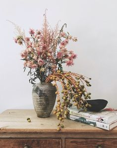foraged floral arrangement of blushing brides and palm dates in ceramic vase. / sfgirlbybay