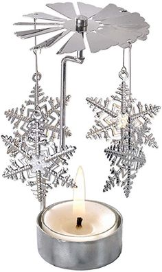 Amazon.com: Bits and Pieces - 5 Inch Rotating Snowflake Tealight Candle Holder - Spinning Scandinavian Design Tea Light: Home & Kitchen