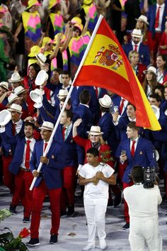 Olympic teams march in Parade of Nations: Celebrating the big moments:  Flag bearer Rafael Nadal of Spain leads his team during the Opening Ceremony of the Rio 2016 Olympic Games at Maracana Stadium on August 5, 2016 in Rio de Janeiro, Brazil.  (Photo by Paul Gilham/Getty Images)