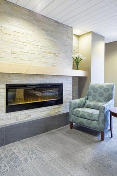 PHOTO TOUR: Park Nicollet Family Birth Center | Healthcare Design -- A family lounge includes a fireplace and lounge seating. Photo: ©AECOM/Robb Williamson