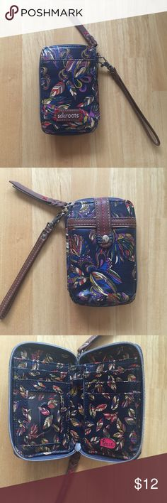 Sakroots Wristlet With Cell Phone Holder EUC Nice Wristlet is navy with multi colored design. In excellent condition. Measures approximately 4x6. Sakroots Bags Clutches & Wristlets