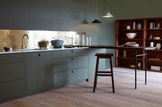 Aged brass splashback. Cabinets and walls in Little Greene's Invisible Green || Naked Kitchens