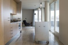 Amsterdam - This kitchen is part of a complete interior design of a 120sqm apartment at the IJ-oever in Amsterdam. It features a space dividing element in the middle of the floorplan that contains the bathroom. Every side of the element has its own function.    //