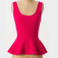 Anthorpologie Pink Peplum Ponte Top Top is a used item in good condition. Low back. Anthropologie Tops