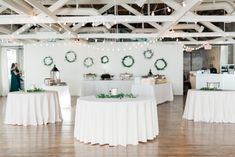 Emilie & Rusty chose simple greenery rings and table decor for their upstairs reception! | Photo: Taylor Dane Photography | Florals: Forever Wild Floral Co | BridgeStreet Gallery & Loft | Birmingham Wedding Venue