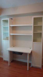 "Here's a cool way to build a ""custom"" Ikea desk unit.  Take 2 Billy bookcases with doors, add a Vika table top with a drawer in between , mount 2 Lack shelves between the bookcases using L-brackets (you'll have to cut them to fit) and voila, you end up with this:"