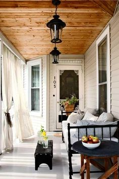 I love the daybed on the porch. And the curtains for privacy. Together they turn the front porch into an outdoor living room. Home, House Exterior, House Design, Sweet Home, Sleeping Porch, Outdoor Rooms, Porch Sitting, Porch, Country Porch