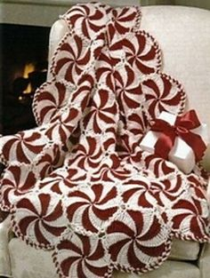 Crochet a holiday classic! Featuring a whimsical peppermint pattern, the Starlight Afghan is one of our best-selling crochet afghans of all time and is perfect for Christmas! Build your crochet kit today with the suggested yarns below. Crochet Afghans, Crochet Diy, Crochet Quilt, Afghan Crochet Patterns, Crochet Crafts, Yarn Crafts, Knitting Patterns, Diy Crafts, Crochet Blankets