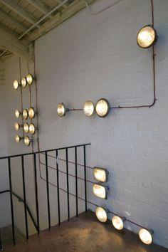 MUR BRIQUE // APPLIQUES INDUSTRIELLES Staircase light installation by .PSLAB | Yatzer