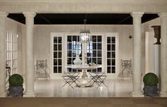 roman inspired design... you can see roman inspiration in this room in the columns that are very simple and tuscan